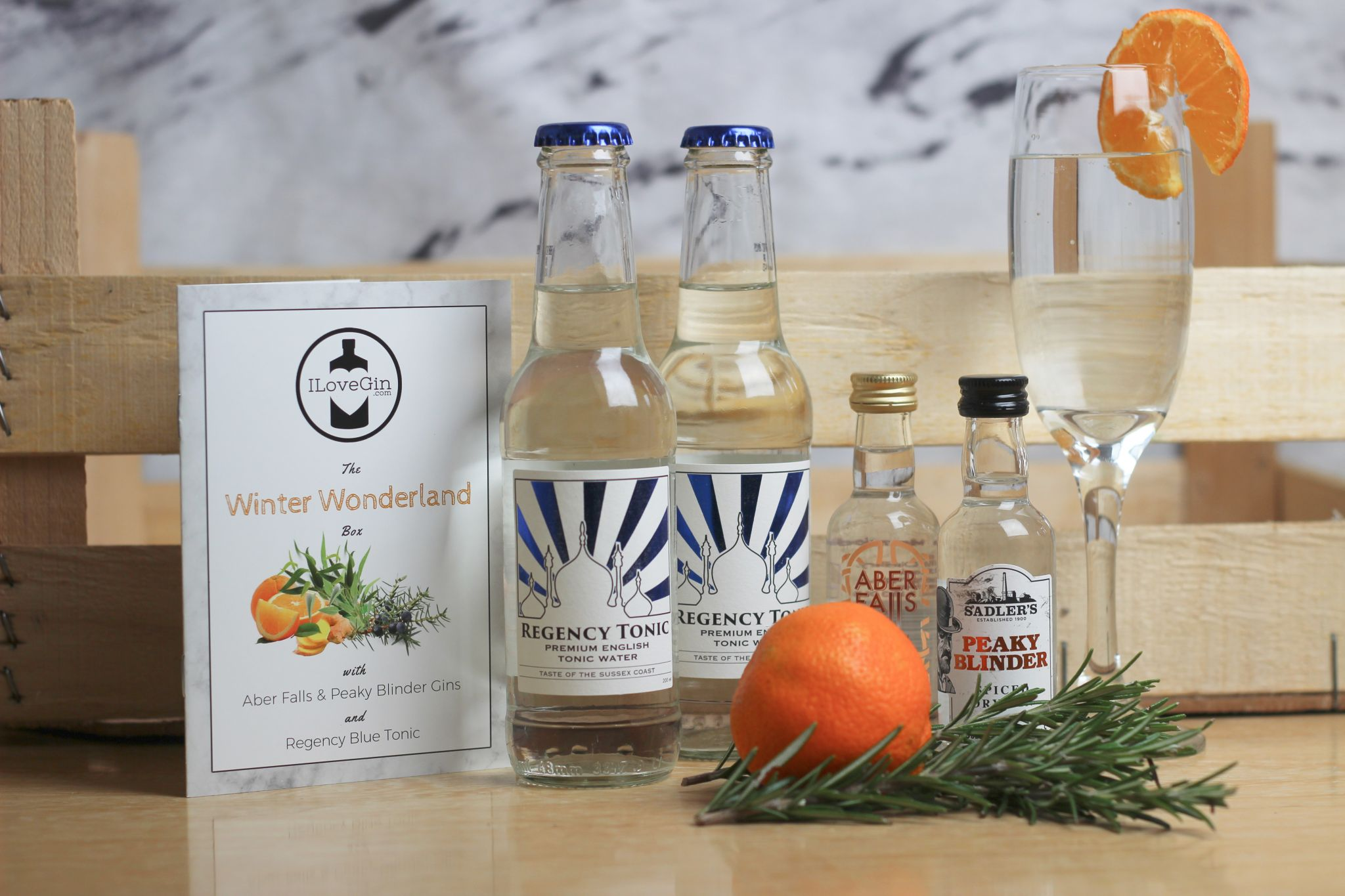 ILoveGin Booklet, Two Regency Tonics, Peaky Blinder Gin and Aber Falls Marmalade Gin on wood background