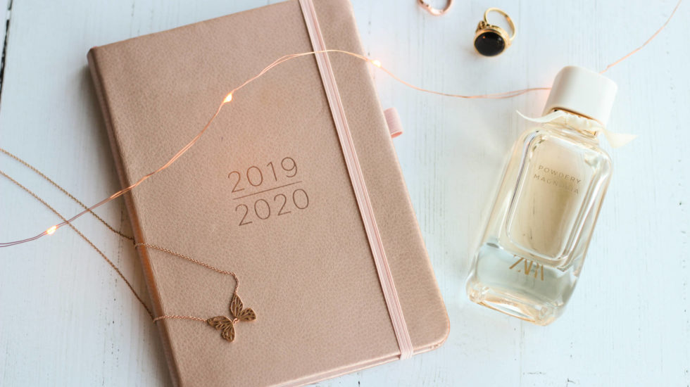 2019/2020 Rose Gold Diary, With Rose Gold lights, rings, necklace and Zara perfume bottle