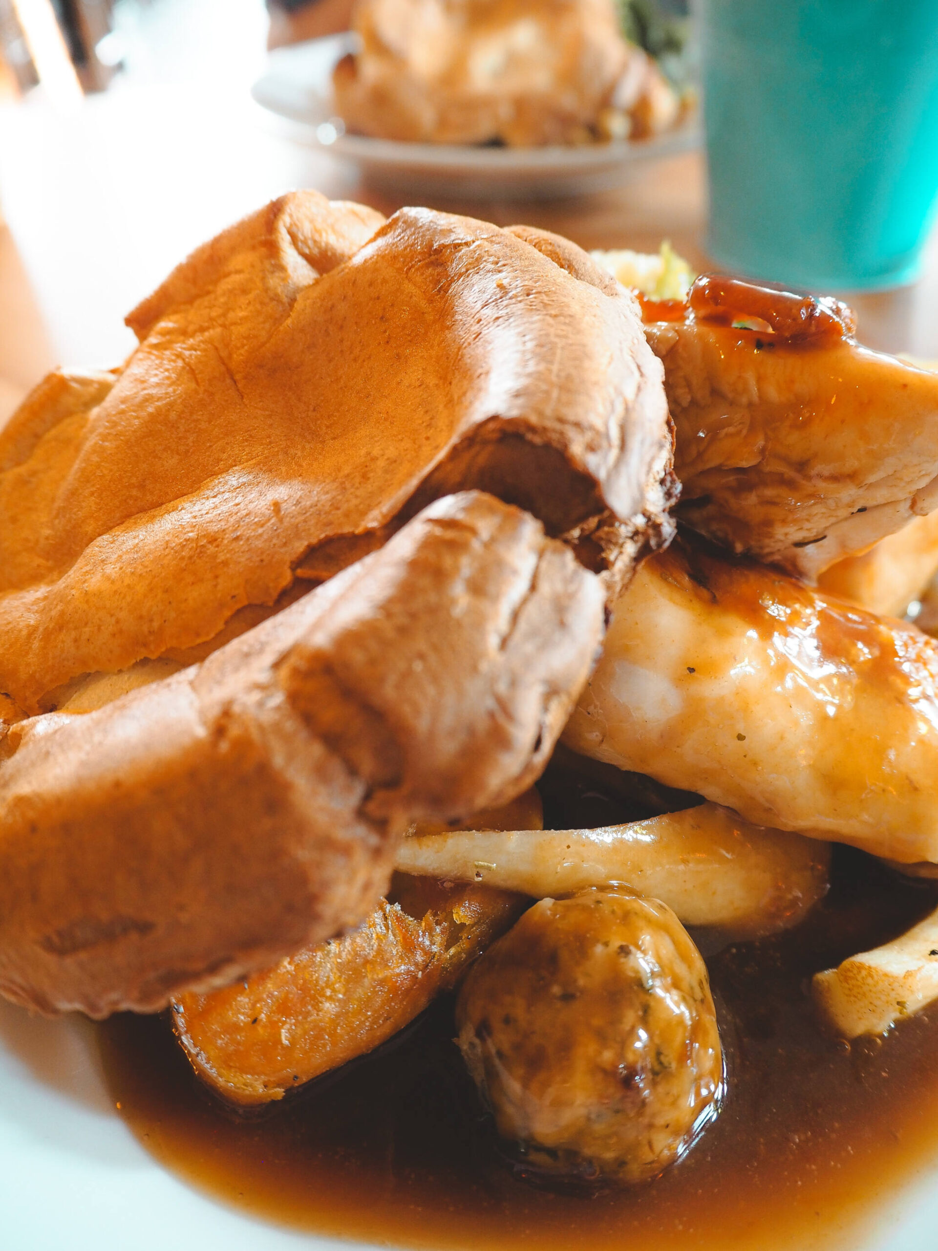 Yorkshire Pudding, potatoes and chicken with lashings of gravy